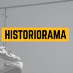 Imagem com uma foto de um par de tênis pendurados em fiação externa. A foto está em tons de cinza. Ao centro, está escrito HISTORIORAMA, em letra preta em um retângulo amarelo.